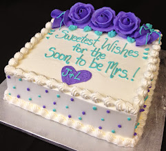 "Photo: Bridal Shower cake: ""Sweetest Wishes for the Soon to be Mrs!"" in Purple & Aqua. Single dots around sides, traditional top & bottom borders, and Purple frosting roses on top w/foliage."