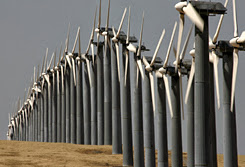 Photo: BYRON, CA - MAY 16:  Rows of wind turbines are seen at the Altamont Pass wind farm May 16, 2007 in Byron, California. According to the online resource SustainLane Government, Oakland, California is well on its way to meeting a California mandate that calls for 20 percent of elctricity purchases to come from renewable sources by the year 2020. Oakland currently leads the nation in green energy by drawing 17% of its electrical power from renewable sources such as solar, geothermal and wind turbines. Much of Oakland's electricty comes from one of the worlds largest wind farms along the Altamont Pass near Livermore, Califonia. The wind farm spans over 78 square miles with over 5,400 wind turbines capable of powering up to 180,000 homes.  (Photo by Justin Sullivan/Getty Images)