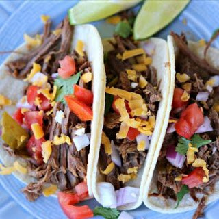 Instant Pot Mexican shredded Beef Tacos.