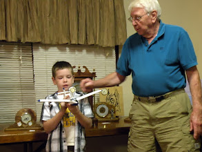 Photo: Charlie and grandson showing hie airplane clock