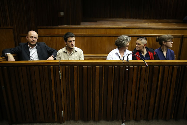 "Zak Valentine, Le Roux Steyn, Marinda Steyn, Cecilia Steyn and Marcel Steyn. The alleged ""Krugersdorp killers""' a group of six accused of carrying out 11 vicious murders' are seen in the High Court in Johannesburg, on April 16 2018."