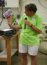 Photo: Tim showed the Montgomery County Fair program and sent it around with the volunteer sign up sheet.