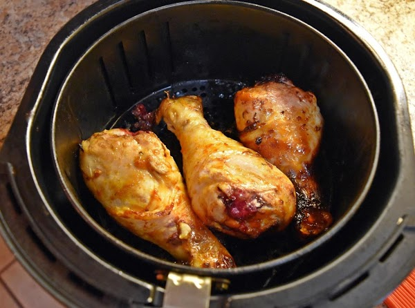 Once preheated place the chicken drum sticks into the hot air fryer basket. I...