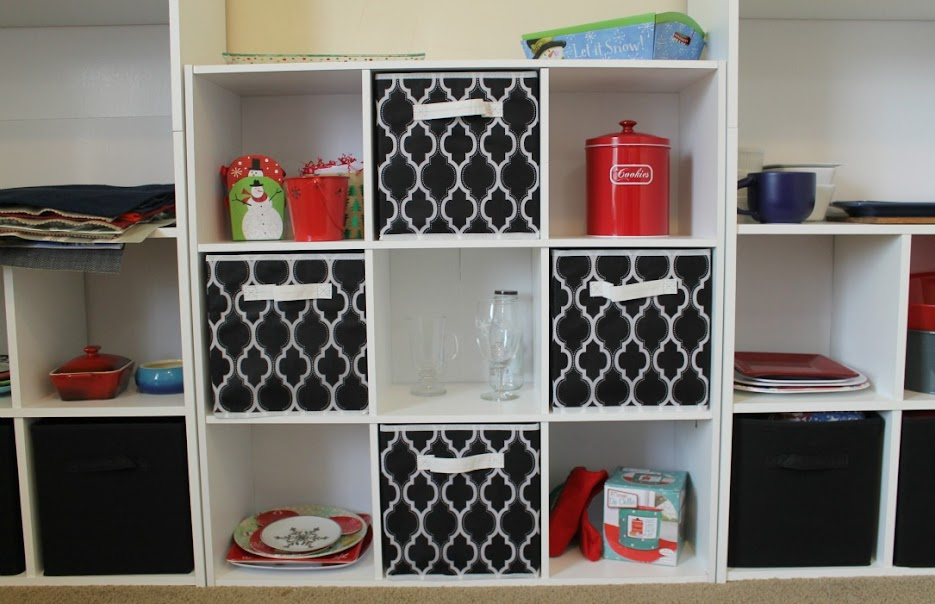 "Bookshelves with built-in cubes at the bottom, plus a 9-cube organizer make a great ""unit"" for home office organization"
