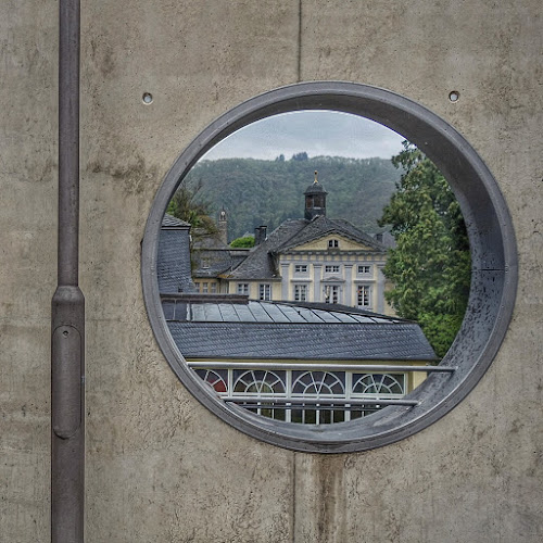 Bad Bertrich - view through bull's eye by Axel K. Böttcher - Buildings & Architecture Architectural Detail ( bad bertrich, architecture, lamp post, concrete, bull's eye )