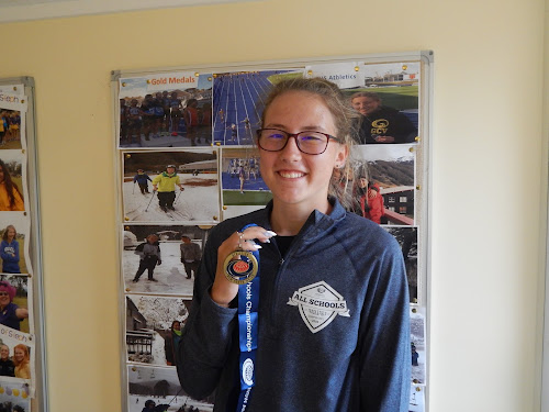 Bella Stewart with her NSW All Schools under-16 high jump gold medal.