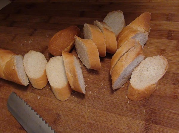 Preheat Oven to BROIL.Place slices of French bread on a baking sheet.  Brush...