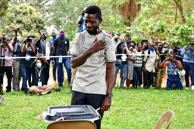 Ugandan presidential candidate and singer Robert Kyagulanyi Ssentamu, known as Bobi Wine, gestures after casting his ballot in the presidential elections in Kampala, Uganda, January 14, 2021.