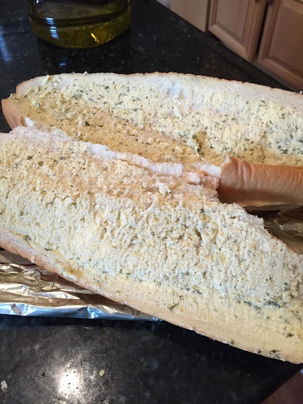 While chicken and broccoli is in the oven - open the garlic bread and...