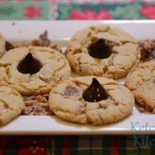 Peanut Butter Thumbprint Cookies w/ Toffee Bits and Dark Chocolate Kisses.