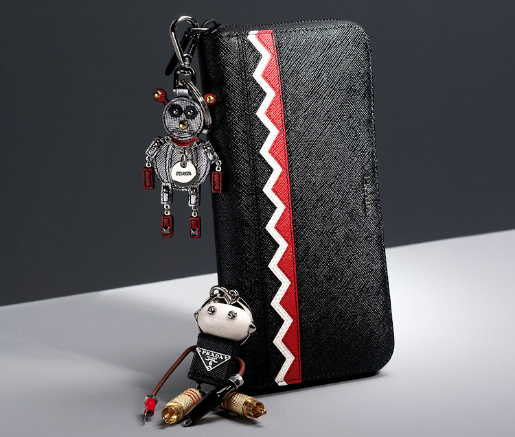 Wallet, R12 550; grey robot, R3 700; Edward robot key ring, R5 300, all Prada