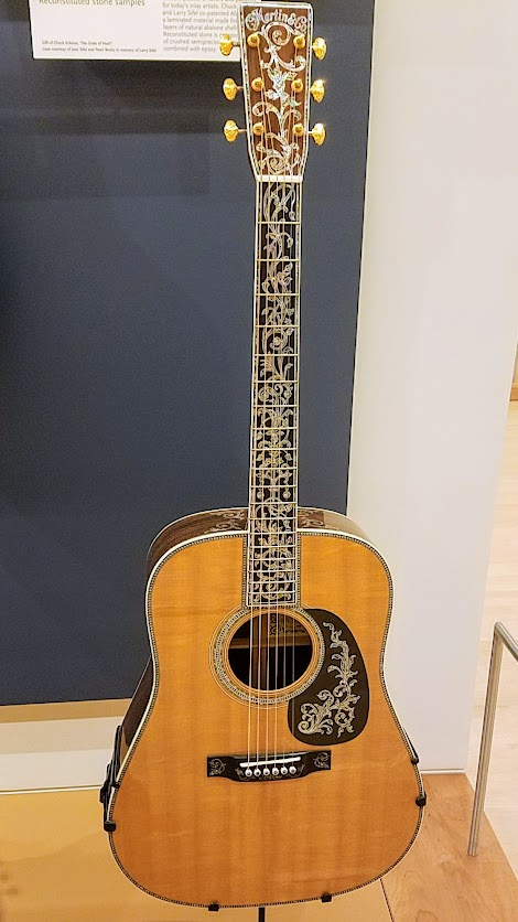 Music Instrument Museum (MIM) Geographic galleries, D-50 Deluxe Guitar fro Pennsylvania, 2001. At the time of its completion, this was the most elaborate Martin guitar model ever made.