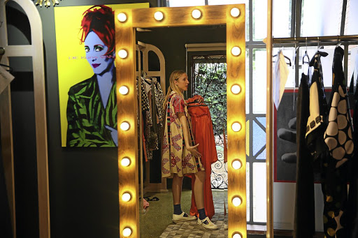 Lezanne Viviers prepares for the Marianne Fassler show at Fashion Week Joburg.