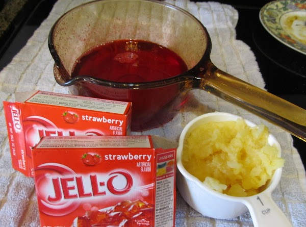 Add pineapple & apples to cranberry mixture and stir in Jello
