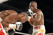 Kaizer Mabuza and Isaac Hlatshwayo during their welterweight bout in Sandton in this file picture.