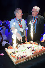 Photo: Gala dinner: Cutting the WODCON 20th anniversary cake. From left:  Anders Jensen, Chairman of WODA, President CEDA (DHI, Denmark) and  Eric Van den Eede, Chairman of the WODCON XX Executive Committee, member of the CEDA Board (Waterwegen en Zeekanaal NV, Belgium)