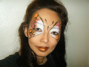 Photo: Butterfly face painting by HeidiBook Heidi by calling 888-750-7024