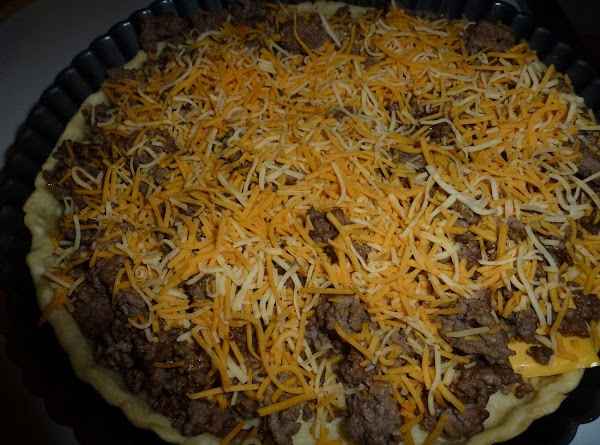 Add 4 slices of american cheese to the bottom of the pie crust, add...