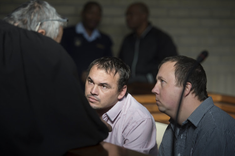 Theo Jackson and Willem Oosthuizen during their appearance at the Middelburg Magistrate's Court for charges of assault and attempted murder of Victor Mlotshwa on June 26, 2017.