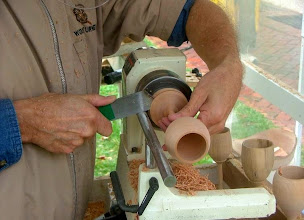 Photo: Doug Bartos, current Chesapeake Woodturners President, parts off another fine goblet...