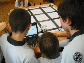 Photo: Kids programming the Infante Robot