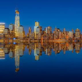 Lower Manhattan skyline at night reflected in water by Jan Gorzynik - City,  Street & Park  Night ( famous, skyline, reflection, harbor, lower, america, metropolis, metropolitan, empire, state, apartment, travel, nyc, cityscape, architecture, ny, usa, business, hudson, city, modern, sky, skyscraper, york, east, light, evening, downtown, financial, water, building, twilight, manhattan, tourism, scenic, dusk, urban, landmark, new, blue, scene, night, view, waterfront, river )