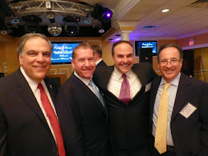 Photo: Popular News 12 meteorologist James Gregorio (2nd from right) is greeted by Mayor Fred Tagliarini, EBC Chairman Carmine Visone and EBC member Bill Parness