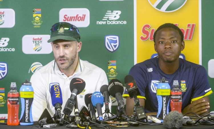 Capatin Faf du Plessis and Kagiso Rabada during day 5 of the 4th Sunfoil Test match between South Africa and Australia at Bidvest Wanderers Stadium on April 03, 2018 in Johannesburg, South Africa.