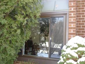Photo: Exterior of brown vinyl sliding window