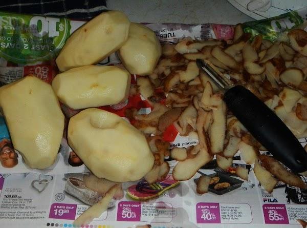 wash and peel potatoes.