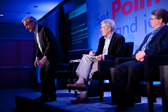 """Photo: Sir Harold Evans makes a point during the """"Austerity: The Promise and Risks"""" panel discussion Friday, Nov. 16, 2012 at the RAND Politics Aside event in Santa Monica, Calif., as Under Secretary Robert Hormats and Stuart Hoffman look on."""