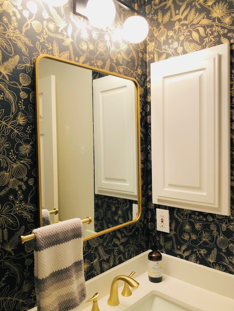 wallpapered sink area