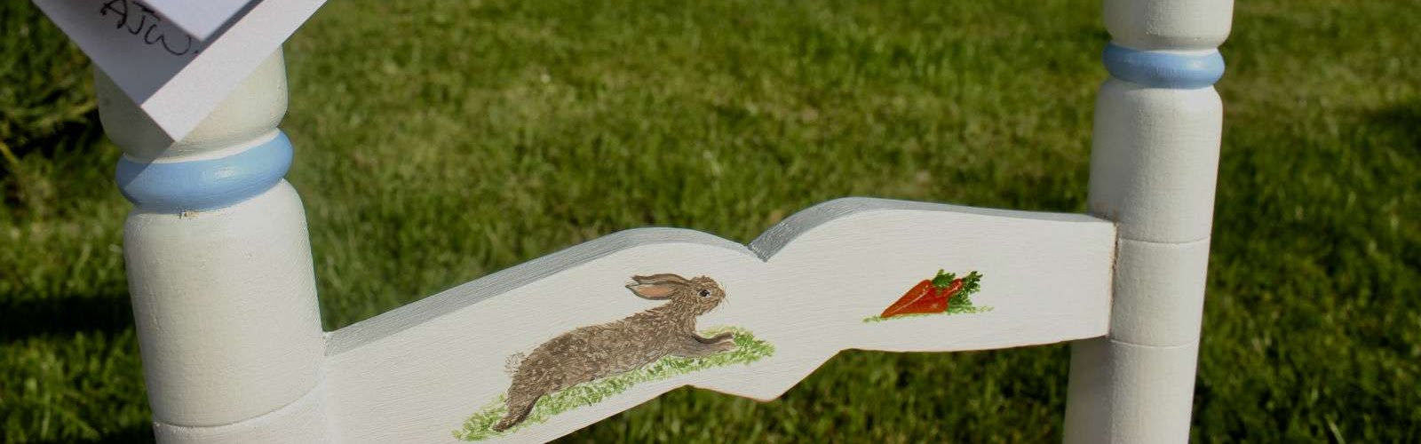 a rabbit on a children's chair