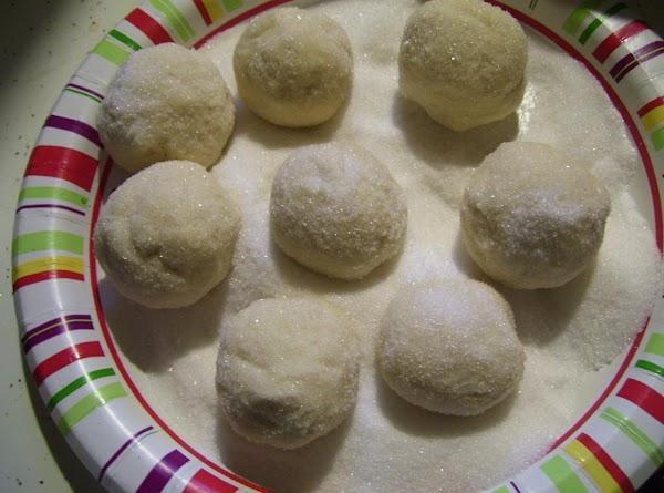 Rolling dough into Balls Then into Granulated Sugar.