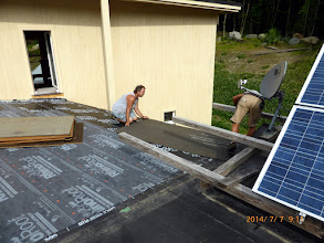Photo: Lonnie & Tim, of Hutchins Roofing, attend to the porch roof - now th@ our fledglings have flown.