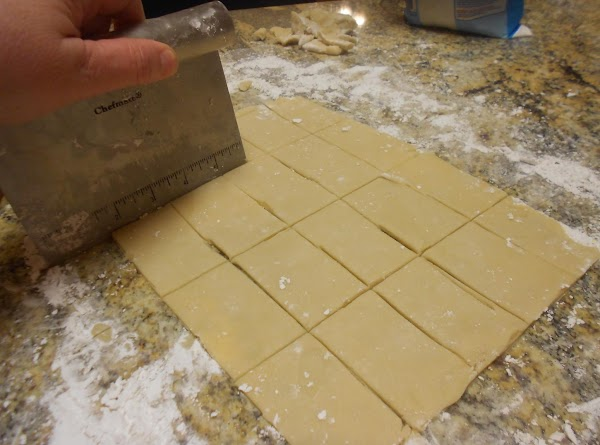 To make the cookies, take 1/4 of the dough and roll it it powdered...