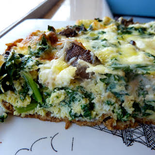 Kale, Mushroom, And Goat Cheese Quiche With A Paleo Crust.