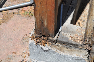 Photo: Dry rot at garage front wall that needs to be replaced.