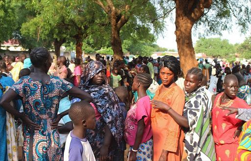 Women displaced in recent fighting queue to receive relief supplies as they camp at the Kator Catholic cathedral compound in Juba, South Sudan, July 12, 2016. Picture: REUTERS