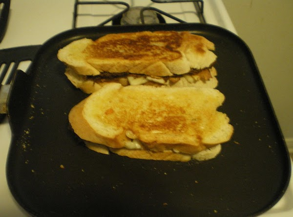 Spread butter on outside of sandwich.  Grill with pork layer closest to the...