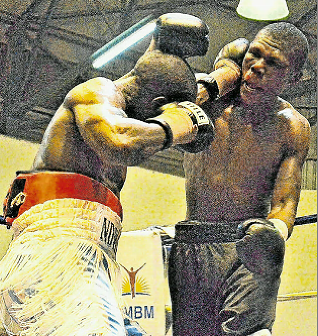 G'town's Mziwoxolo Ndwayana, left, delivers a punch to Anelisa Gungqisa during their WBF International welterweight fight at the Lillian Ngoyi Sport Centre in Kwazakhele last night. Ndwayana has returned to the Eastern Cape to prepare for an SA welterweight showdown