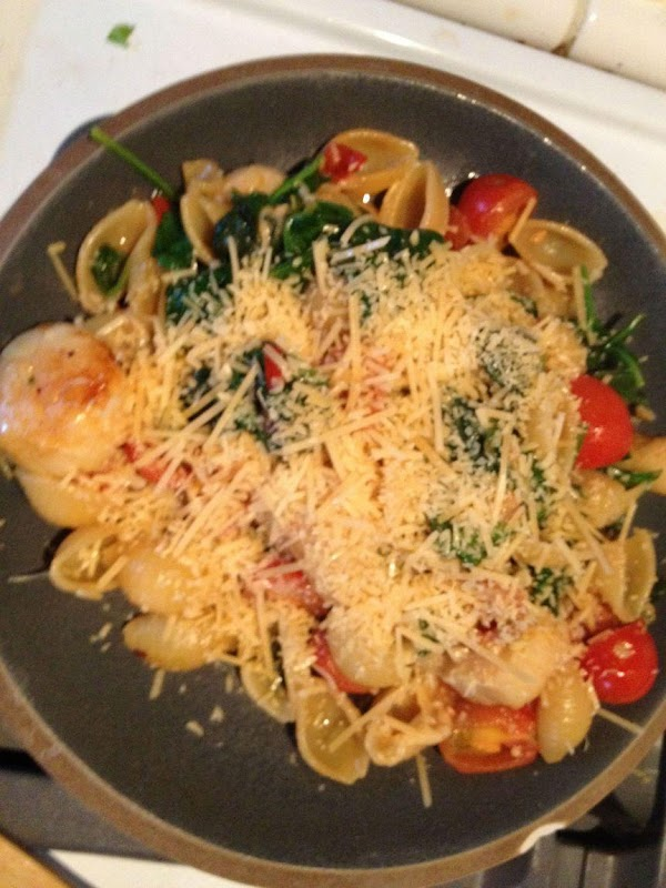 Serve and top with more grated parmesan.