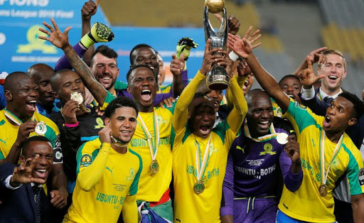 Sundowns players celebrate with the trophy after winning CAF African Champions League. Picture: REUTERS, AMR ABDALLAH DALSH