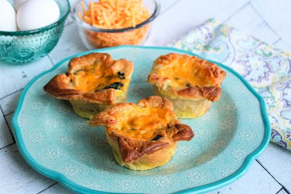 Spinach Quiche Muffins On A Plate.