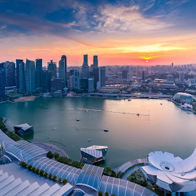 The Lion City during a Sunset by Binoy Uthup - City,  Street & Park  Skylines ( cityscapes, digital blending, hdr, waterscape, marina bay sands, aerial, travel, architecture, cityscape, singapore, marina bay, city, urban, hdr phtography, cbd, vertical panorama, blue, sunset, mbs, skypark, central business district )