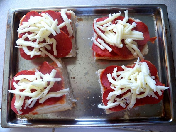 Top with 5 slices of pepperoni and desired amount of cheese on each.