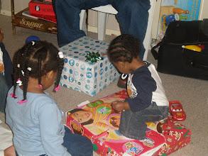 Photo: Keon standing on top of Kaleya's present.