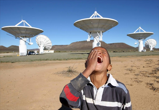 EYE ON THE SKY:  A boy enjoys a tour of the SKA site in the Northern Cape.   Picture: SUNDAY TIMES