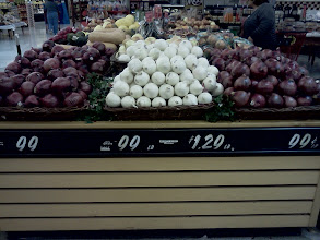 Photo: The onion display looked so nice, my mom is grabbing our potatoes for dinner in the background.