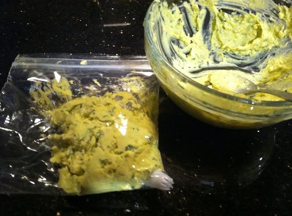 SPOON THIS MIXTURE INTO A SMALL PLASTIC BAG WITH DECORATOR PASTRY TIP PUSHD INTO...